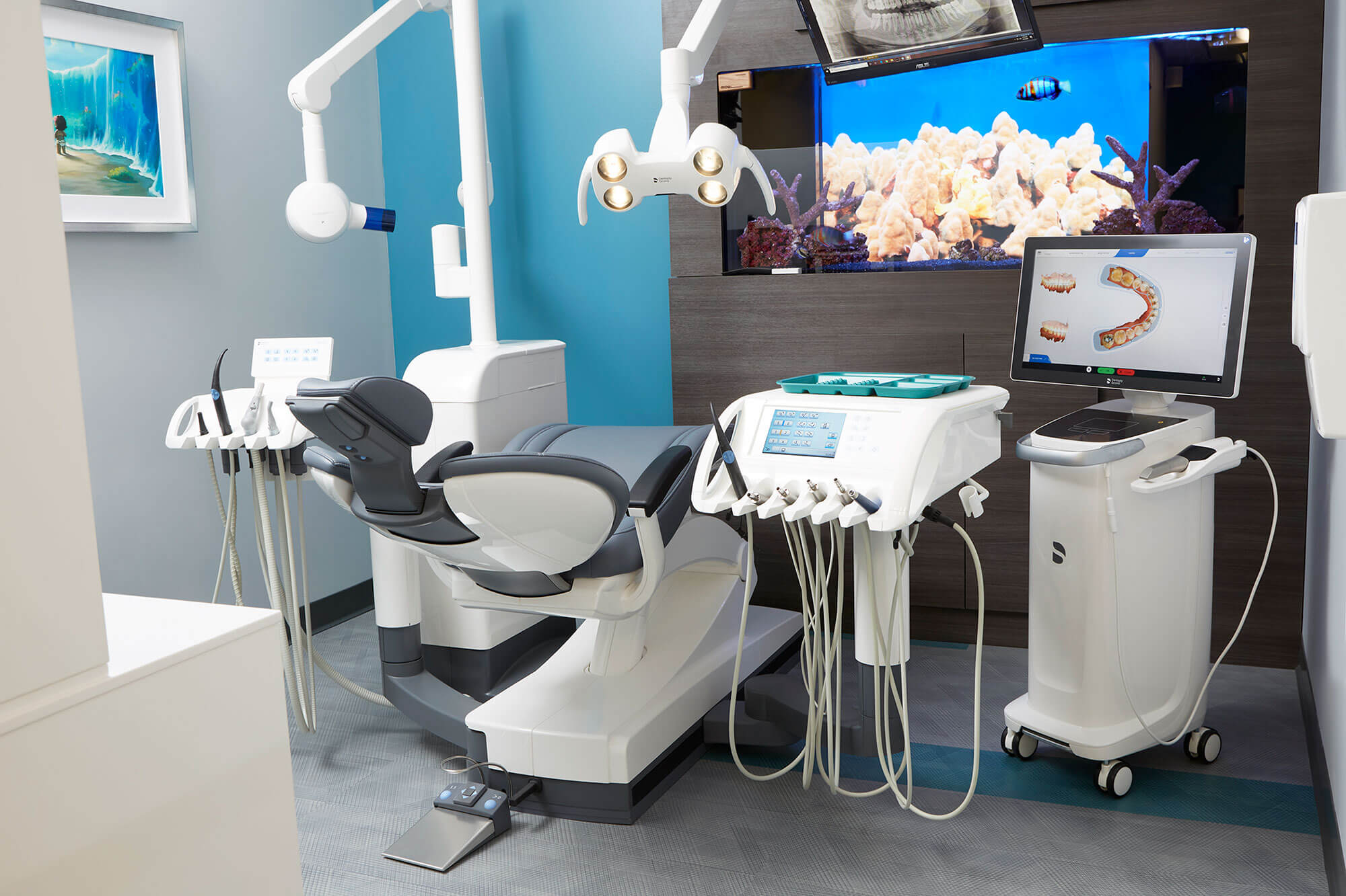 dental exam room with chair and dental equipment