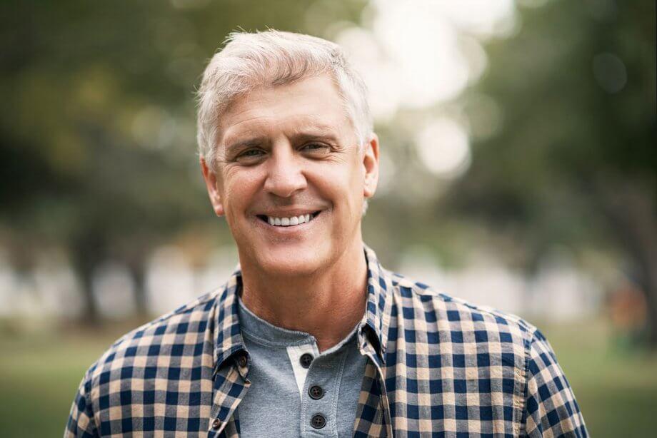 smiling older man outside