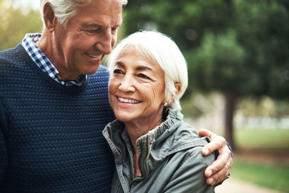 older man with arm around older woman