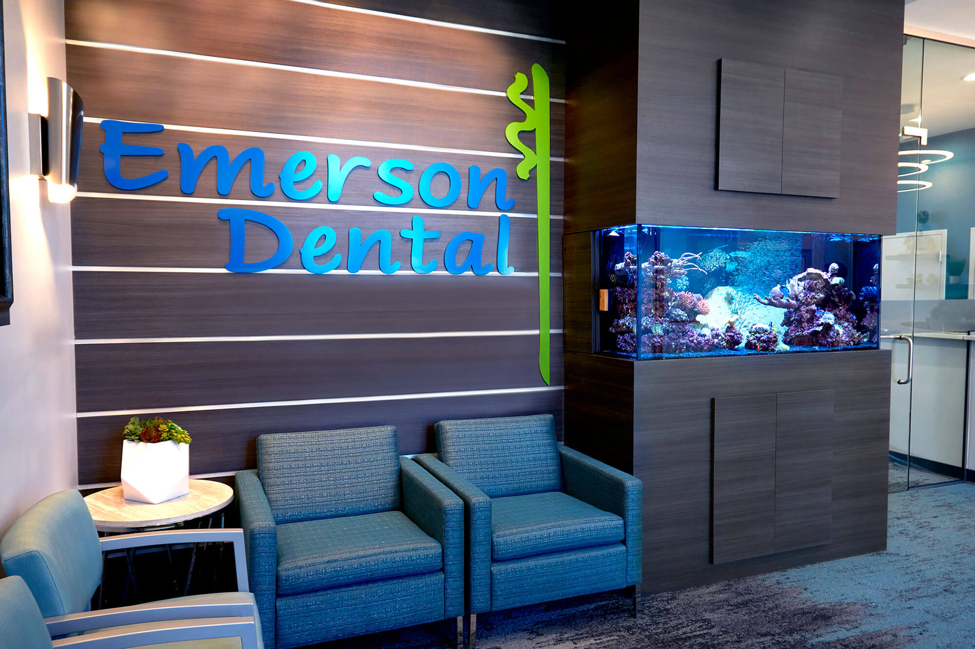 waiting room at Emerson Dental with fish tank in wall