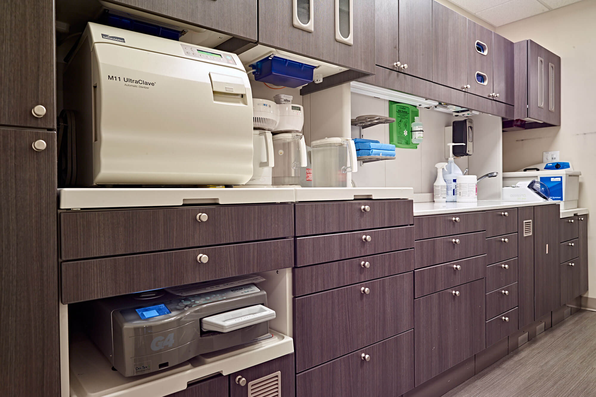 cabinets in work area of dental office with sterilizer