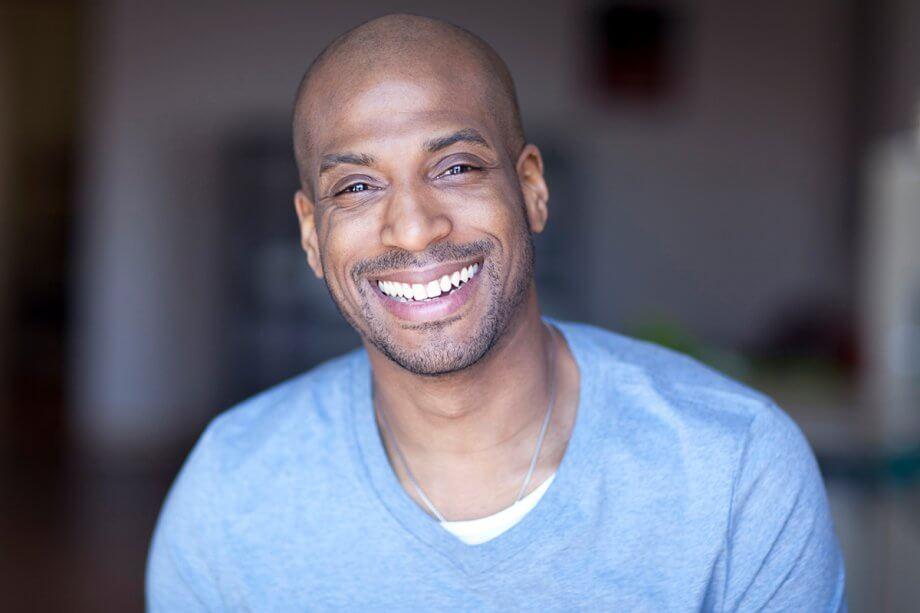 smiling man in blue shirt